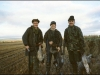 Three happy wildfowlers