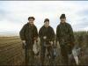 Three happy wildfowlers